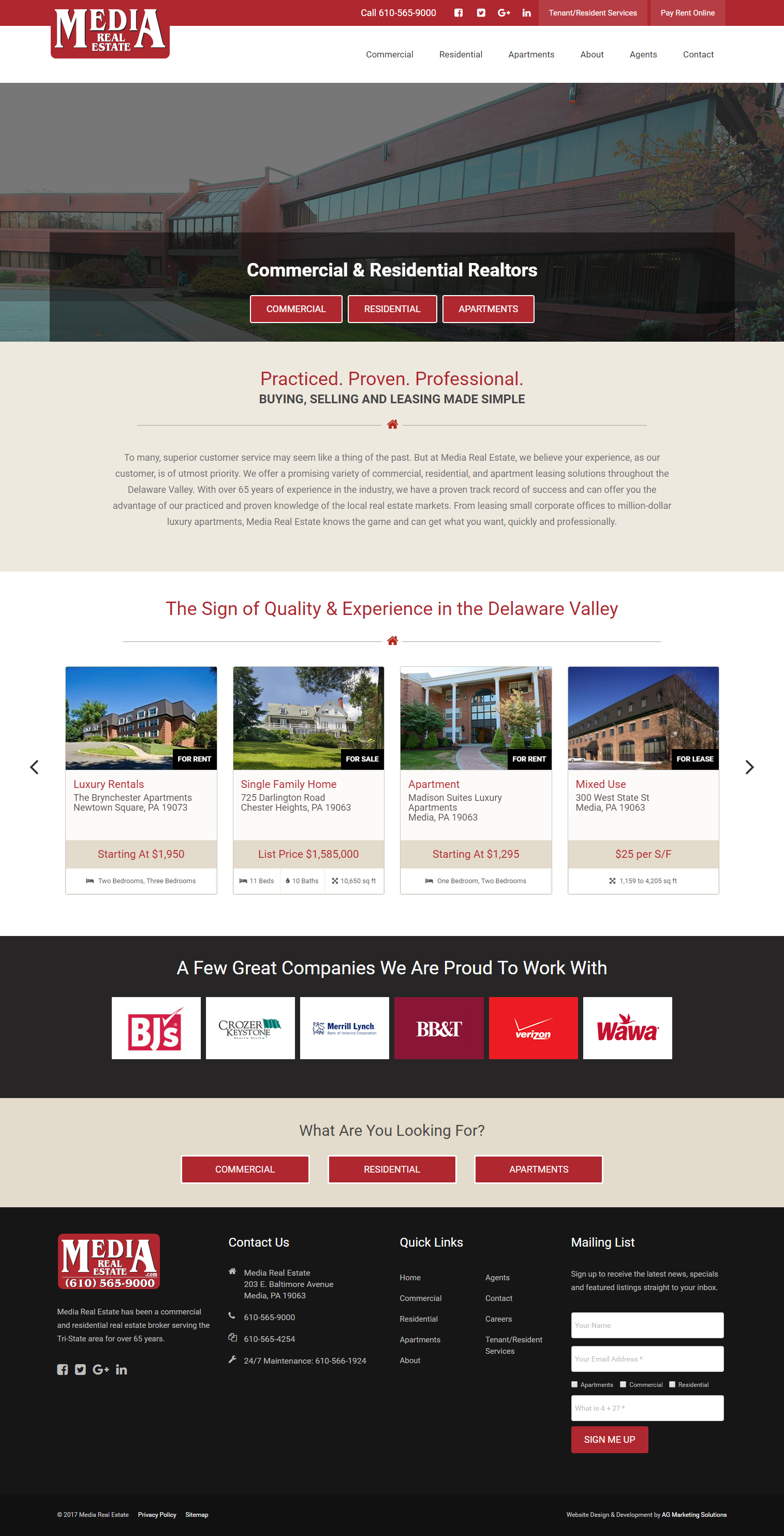 Media Real Estate responsive website on a MacBook Air