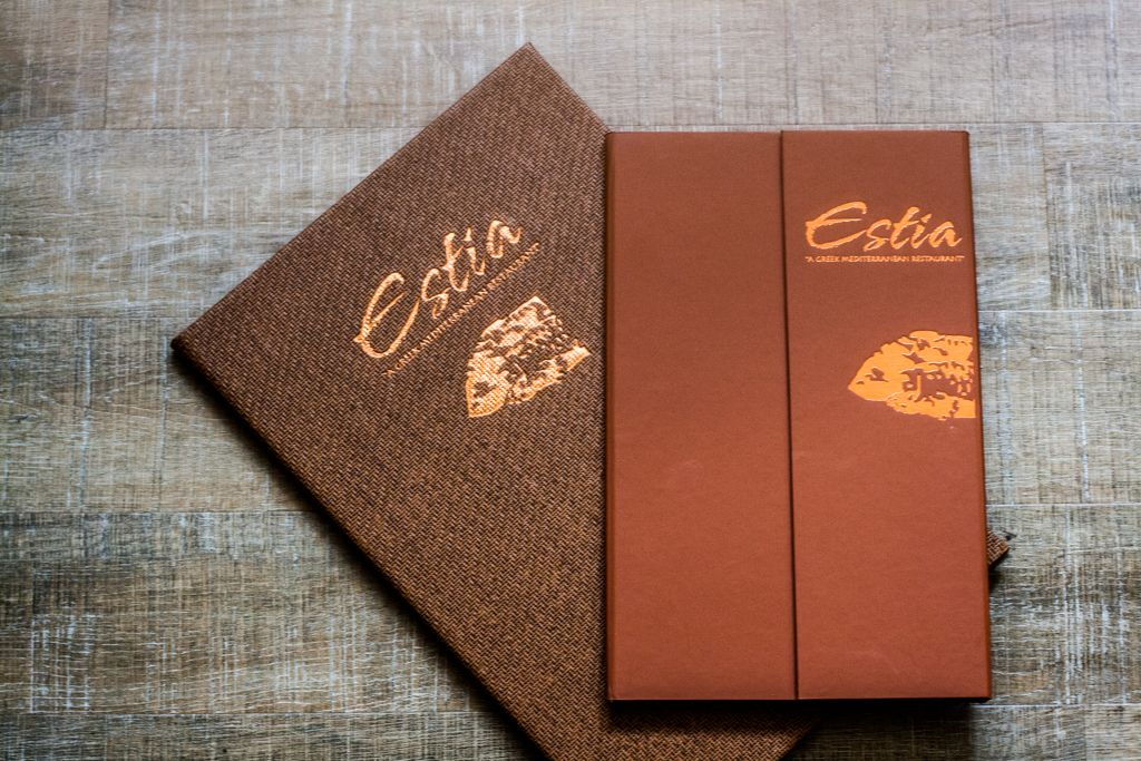 Estia Restaurant gold leaf engraved menu covers