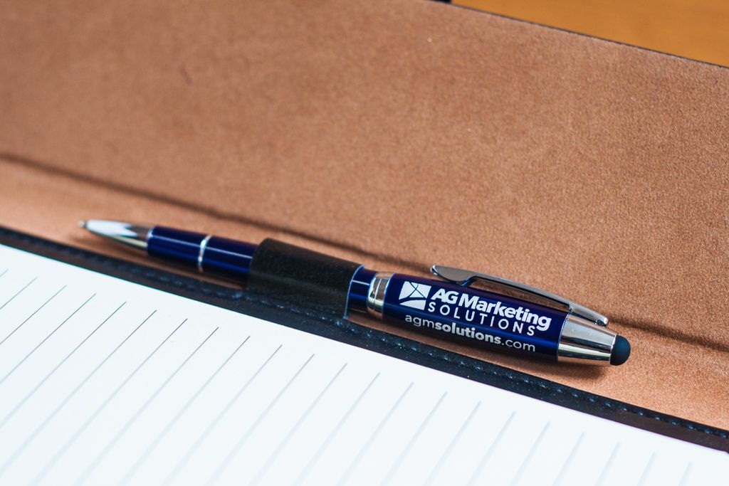 Metal pen with stylus printed with AG Marketing Solutions and website address